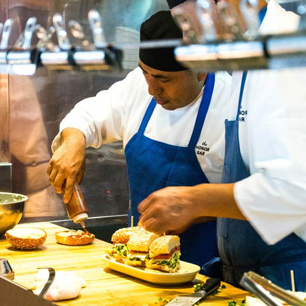 chefs preparing a crispy chicken sandwich